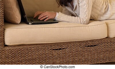 Mirthful woman using a laptop