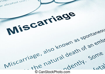 Miscarriage sign on a paper and glasses.