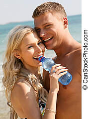 Mischievous couple on the beach