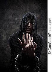 Miserable cultist - Portrait of miserable chained young man...