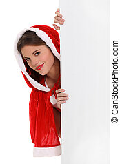 Miss Santa peeking round a board left blank for your message