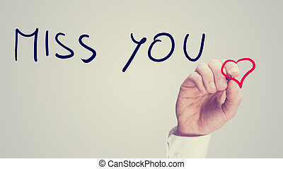 Miss You message on a virtual screen - Retro image of a man...