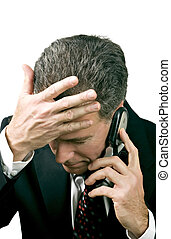 Missed Appointment - Businessman on a cell phone reacting in...