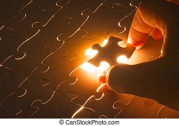 Missing jigsaw puzzle piece with light glow