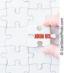Missing jigsaw puzzle piece with message JOIN US