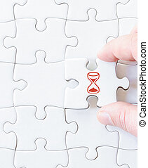 Missing jigsaw puzzle piece with SAND GLASS symbol