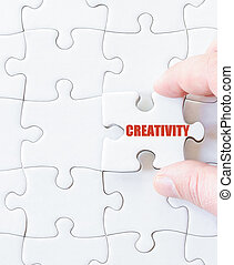 Missing jigsaw puzzle piece with word CREATIVITY