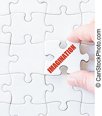 Missing jigsaw puzzle piece with word IMAGINATION