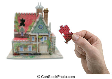 missing link - house with hand and missing piece isolated on...