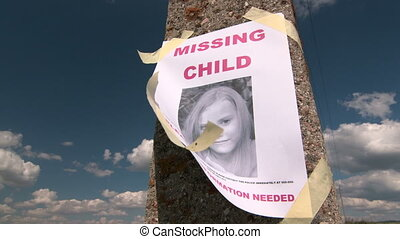 Missing person poster with photo of child