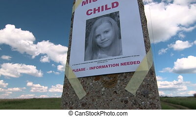 Missing person poster with photo of little girl are posted...