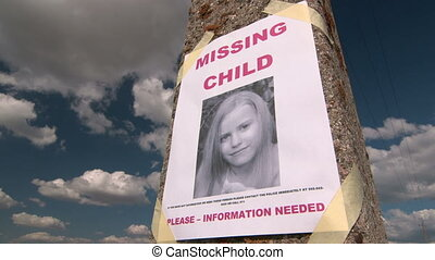 Missing person poster with photo of little girl
