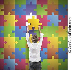 Missing piece - Young boy holds the missing piece of the...