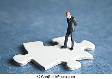 missing pieces of the puzzle - Businessmen figurines...