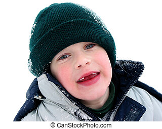 Missing teeth - Young boy having fun with snow outdoors in...