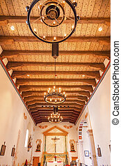 Mission San Luis Obispo de Tolosa, Wooden Ceiling, Basilica, Altar, Cross San Luis Obispo California. Founded 1772 by Father Junipero Serra. Named for Saint Louis of Anjou