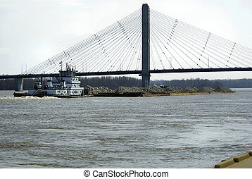 Photograph of a barge going under the Bill Emerson Bridge at Cape Girardeau Missouri