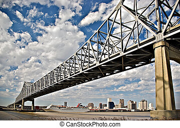 The Crescent City Bridge, crossing the Mississippi River in downtown New Orleans, Louisiana.