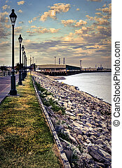 The Mississippi River levee and rock revetment on the Moonwalk Riverfront, New Orleans