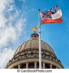 Mississippi state flag flying in front of capitol building in Ja