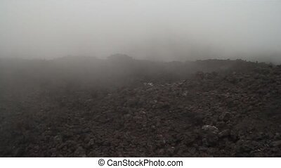 Mist covering a lava field of the Pacaya volcano, Guatemala
