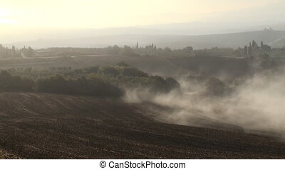 Mist - Dew coming in as the sun rises over the Tuscan Val d'...
