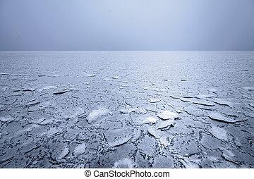 mist on a frozen lake