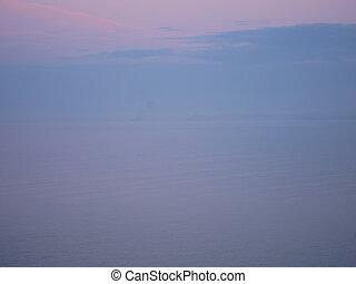 Mist on the sea at sunset