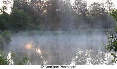 mist raising over pond