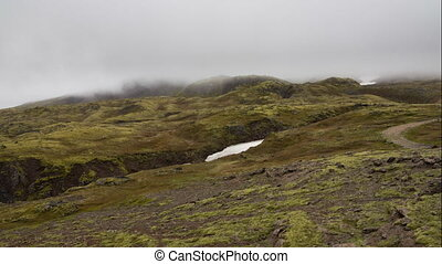 Time Lapse of mist over lava mountains in Iceland