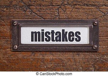 mistakes - file cabinet label - mistake - file cabinet label...