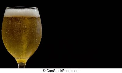 Misted glass of beer with froth