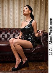 Mistress - A young brunette lady mistress and leather couch...