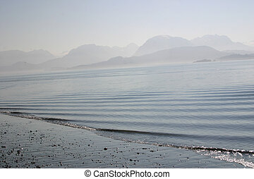 Misty Bay - Misty sunrise over Kachemak Bay off the Kenai...