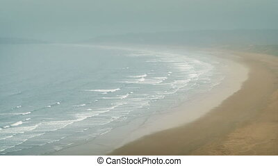 Misty Beach Landscape - Wide shot of sea and beach on misty...