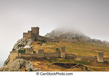 Misty dawn of a medieval castle