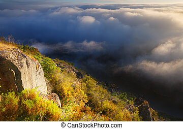 Misty dawn over mountains