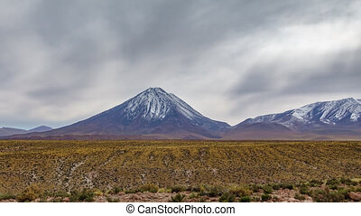 Misty day over Licancabur volcano in Atacama - Time lapse on...