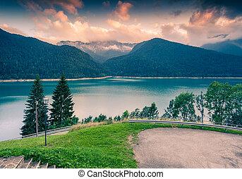 Misty evening scene on the Sauris lake, Friuli-Venezia...