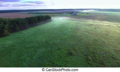 misty fields in morning birds eye view - misty fields in...