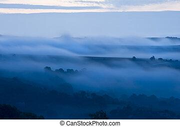 Misty foggy morning sunrise