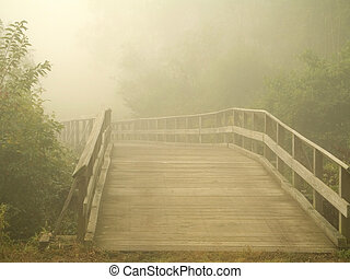 Misty Footbridge - This is a shot of a wooden footbridge...