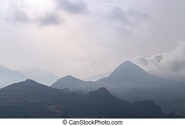 misty greek landscape with mountains