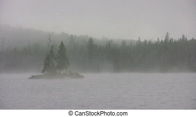 Stock 1080i Video Footage of morning mist on lake with island