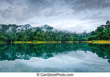 Misty morning on Cheow Lan Lake, Khao Sok National Park, Thailand