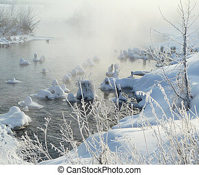 Misty morning on river in winter