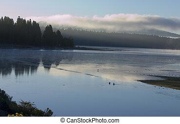 Misty morning sunrise on lake almanor