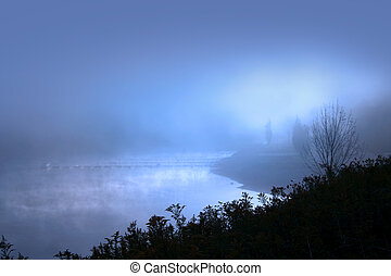 Misty morning with sun raise over lake