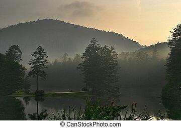 Misty Mountain Sunrise on Lake