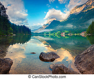 Misty summer morning on the Hintersee lake
